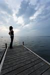 stillness_womanonjetty_pshrink35.JPG